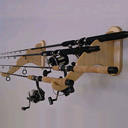 Fishing pole rack fishing pole wall rack cozywinters for Fishing pole wall rack